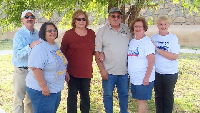 John Song, left, Frances Gonzales, Carmen Martinez, Rudy Martinez, Frances Vasquez and Mary Hotvedt pose for a photo at the Bayard Bash at the Park on Saturday.