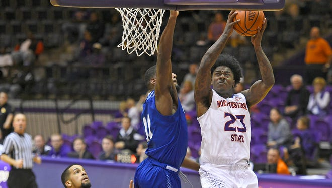Northwestern State's Zeek Woodley goes up for a shot against New Orleans on Saturday.