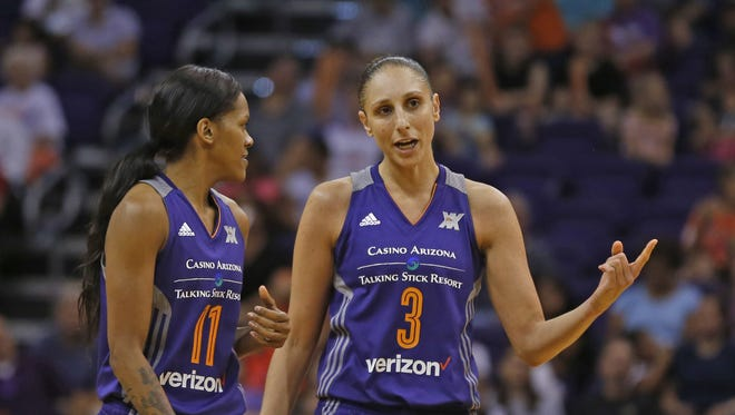 Mercury's Diana Taurasi (3) talks to Courtney Williams during a break in action in the first half at Talking Stick Resort Arena on June 9, 2016 in Phoenix, Ariz.