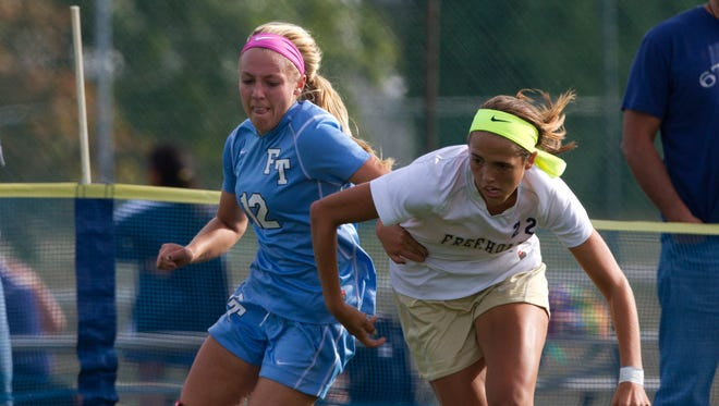 Freehold Townships Lacey Powell and Freehold Boro's Carly Columbe fight for a loose ball during first half action . Freehold Township Girls Soccer vs Freehold Boro in Freehold Boro  on September 25, 2015.