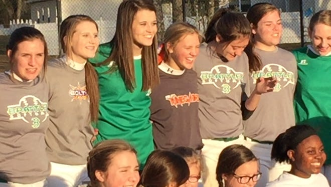 Alex Wilcox, her Brantley teammates and future Brantley Bulldogs pose for pictures after a benefit clinic for her January 24, 2016.