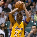 Kobe Bryant saw his first game action since January in the Lakers' preseason opener.
