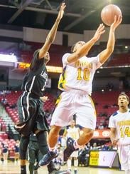 Pocomoke point guard Tyler Nixon (10) takes a shot
