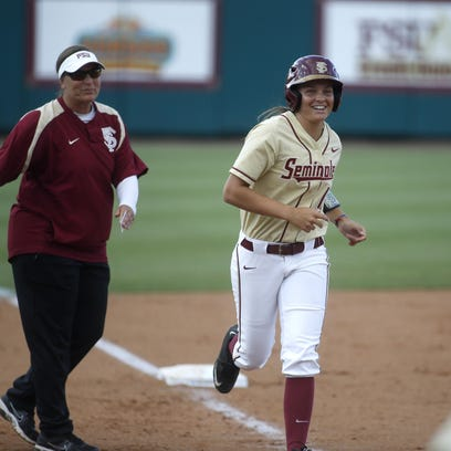 FSU's Cali Harrod trots home to her teammates after