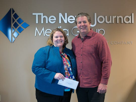 Carrie Gray with Wilmington Renassaine Corp receives a Gannett Foundation Grant Money from Thomas Donovan, President/Publisher and Northeast Regional President of Gannett East Group.