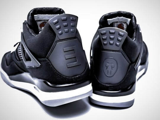 53ee409a990f70 Rare Eminem Nike Air Jordan 4 kicks up for auction