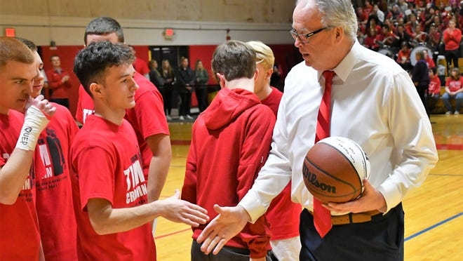 Tim Cronin, right, spent nearly 40 years as a basketball coach in Rochester, the last 19 as the head coach of the Spaulding High School boys team. Cronin resigned from his post earlier this month.