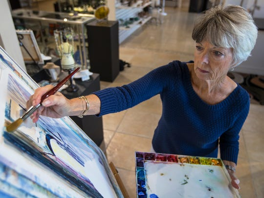 Painter Shirley Hales works on a water color image