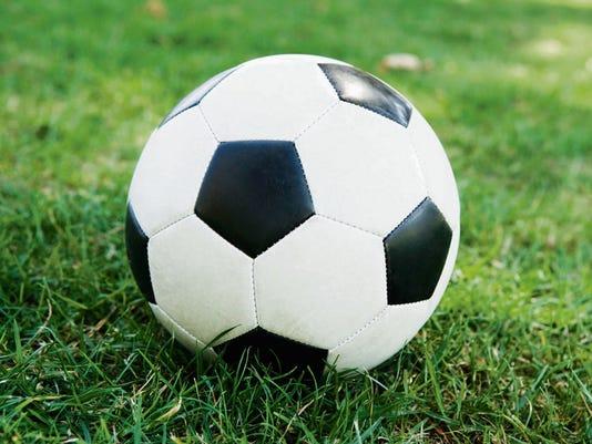 636083836621552041-soccerball-grass.jpg