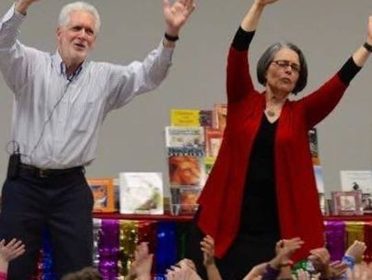 Mitch Weiss and Martha Hamilton tell a story to schoolchildren.