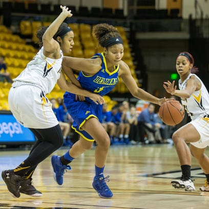Delaware's Courtni Green seeks a path to the basket at Towson.