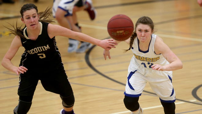 Bremerton High School basketball player Brianna Lammi (right) chases down a loose ball with Sequim's Kyla Armstrong on Friday night at Bremerton.