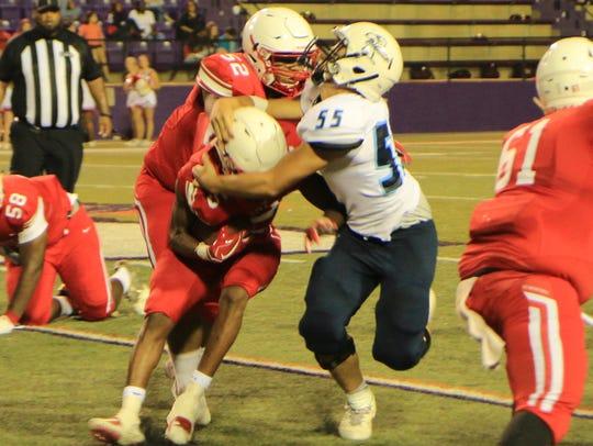 Loyola's Thomas Hebert makes a tackle.