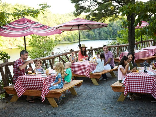 Families enjoy an al fresco meal at Mohonk's Granary