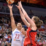 Atlanta's Shoni Schimmel, left, puts up a shot over Washington's Emma Meesseman during their game Saturday, May 23, 2015, at the KFC Yum! Center. (Photo by Timothy D. Easley/Special to the C-J)