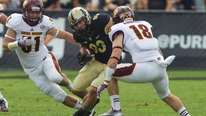 Purdue's B.J. Knauf looks to split Central Michigan defender Cody Lopez, left, and Tony Annese during their game Saturday, September 6, 2014, at Ross-Ade Stadium in West Lafayette. Purdue loss 38-17.