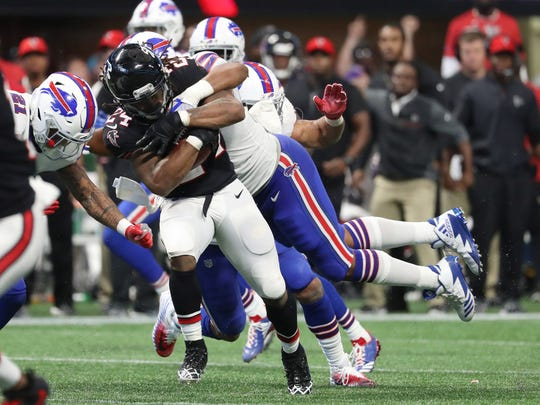 Buffalo Bills defensive end Eddie Yarbrough (54) tackles Atlanta Falcons running back Devonta Freeman (24) in the fourth quarter.