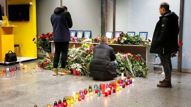 Relatives of the flight crew members of the Ukrainian 737-800 plane that crashed on the outskirts of Tehran, mourn at a memorial inside Borispil international airport outside Kyiv, Ukraine on Wednesday. A Ukrainian airplane carrying 176 people crashed on Wednesday shortly after takeoff from Tehran's main airport, killing all onboard, Iranian state TV and officials in Ukraine said.