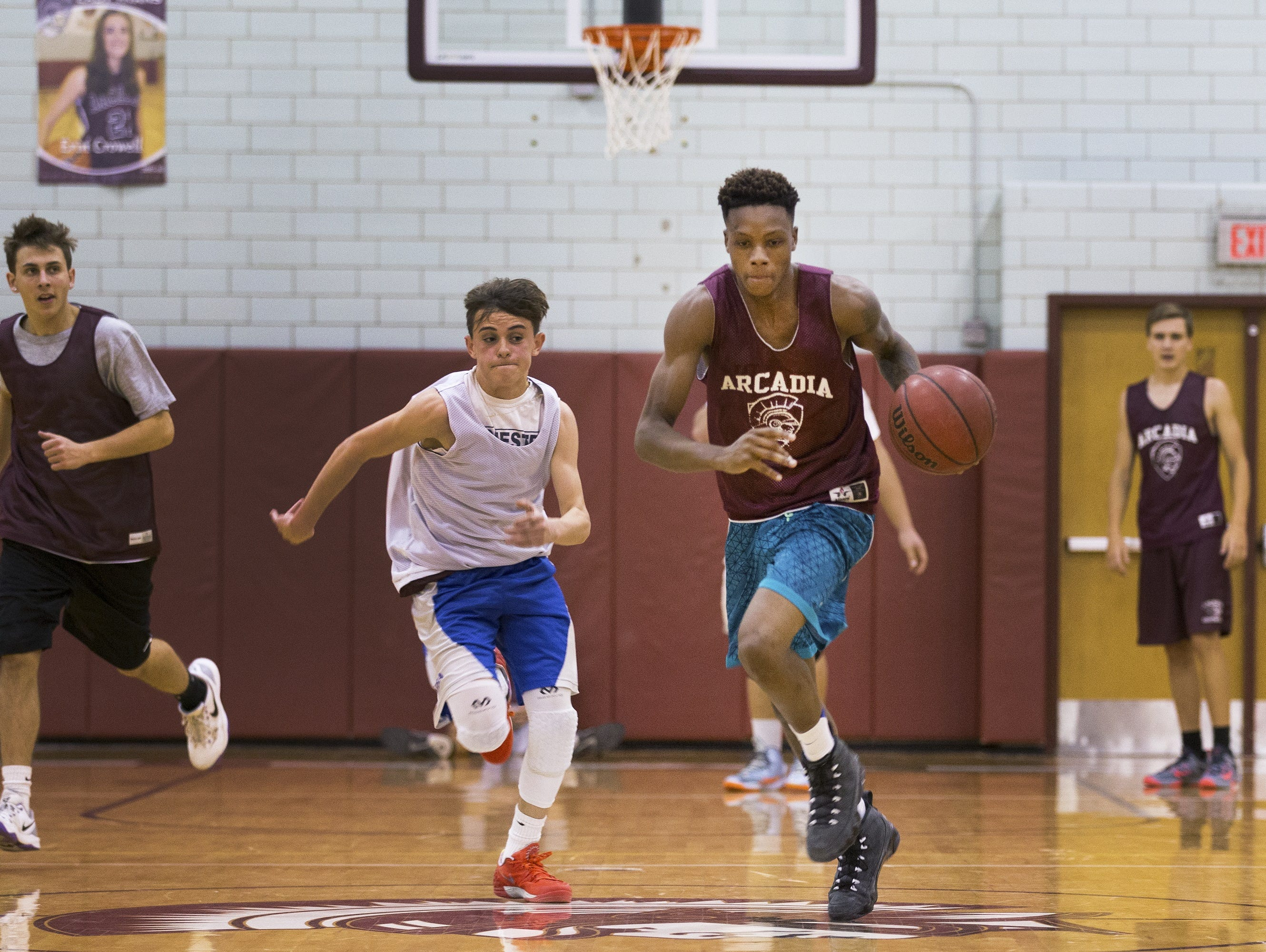 Greece Arcadia senior forward Keith McGee runs down the ball during a scrimmage in practice.