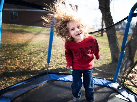 Gabriel Loudon, 5, jumps on a trampoline at his house in Greer on Tuesday, January 31, 2017.