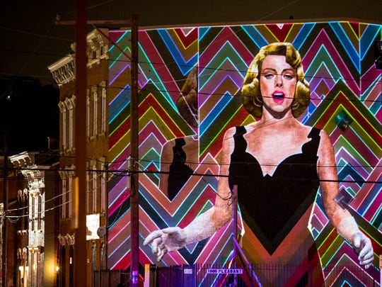 Blink Cincinnati features more than 20 large-scale architectural projections. One piece on Pleasant Street activates this ArtWorks mural tribute to singer and actress Rosemary Clooney.