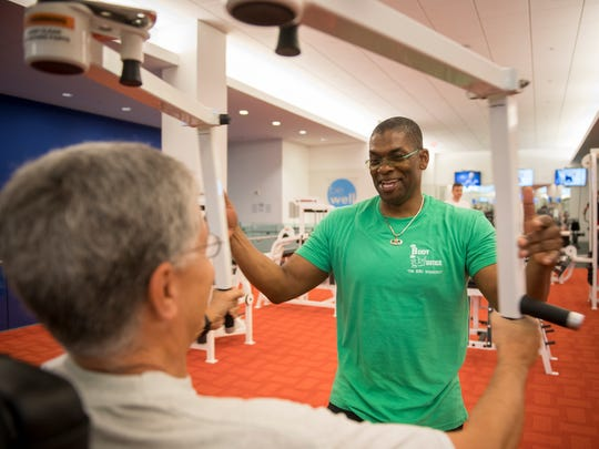 Justice Ruth Bader Ginsburg's personal trainer, Bryant Johnson, helps Supreme Court correspondent Richard Wolf through the justice's workout.