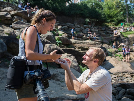 Greenville News Staff Photographer Lauren Petracca is proposed to following the solar eclipse in Falls Park.