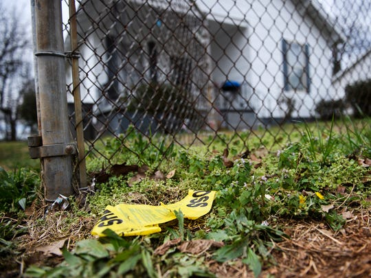 A torn piece of yellow tape is still left in front of the home of Jermaine Massey, who was shot and killed by Greenville County Sheriff's Office deputies earlier this week near Poe Mill on Wednesday, March 21, 2018.