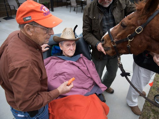Dr. John B. Martin Jr. and his friend, Benny Henderson, visit with horses at Clemson Downs on Tuesday, March 25, 2018. Dr Martin, who is in hospice care, used to breed and train quarter horses.
