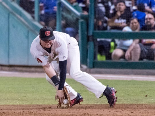 Visalia's Pavin Smith takes a hit ball during the 2018