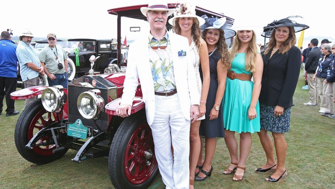 David ( left) and Charlotte ( Far right) Morrison of Long Beach, Calif., with daughters Christine, 16, Catherine, 21, and Carolyn, 23, with the 1912 Rolls-Royce Silver Ghost Rothchild et Fils style limousine.at the Pebble Beach Concours D'Elegance.