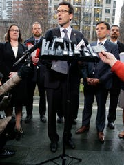 Washington Attorney General Bob Ferguson talks to reporters Friday, Feb. 3, 2017, following a hearing in federal court in Seattle. A U.S. judge on Friday temporarily blocked President Donald Trump's ban on people from seven predominantly Muslim countries from entering the United States after Washington state and Minnesota urged a nationwide hold on the executive order that has launched legal battles across the country.