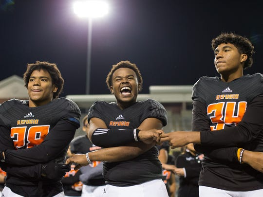 Refugio's Jacobe Avery loughs during the schools song after wining the Class 2A D-I State Semifinal game against San Augustine 63-21 at Cy Fair FCU Stadium in Cypress, Texas on Thursday, Dec. 14, 2017.
