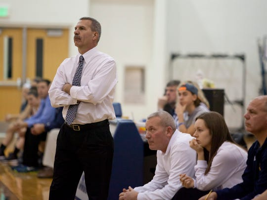 Port Huron Northern coach Mark Dickinson watches from the sidelines during a basketball game Friday, Dec. 5, 2014 at Marysville High School.