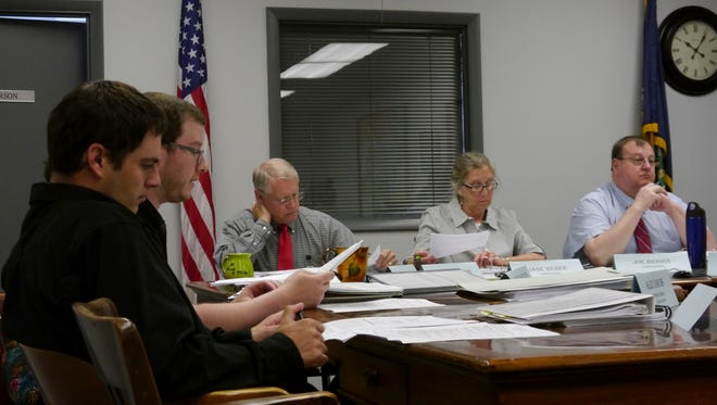 From left, members of the Cascade County planning staff Alex Dachs and Sandor Hopkins present zoning changes to Cascade County Commissioners Jim Larson, Jane Weber and Joe Briggs.