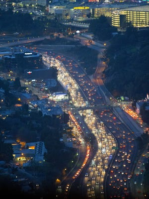 Traffic on local highways in the Los Angeles area as seen from the Osprey helicopter transporting members of the media traveling with President Barack Obama, Thursday, Feb. 11, 2016.