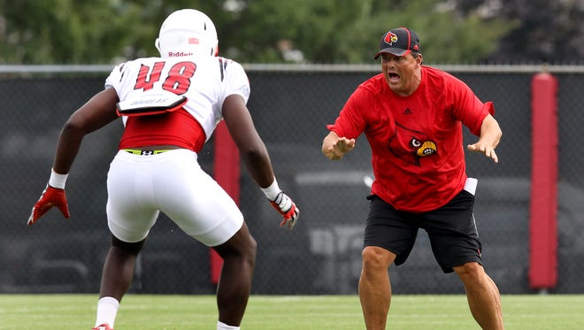 Assistant coach Todd Grantham works with his players in practice. August 7, 2014
