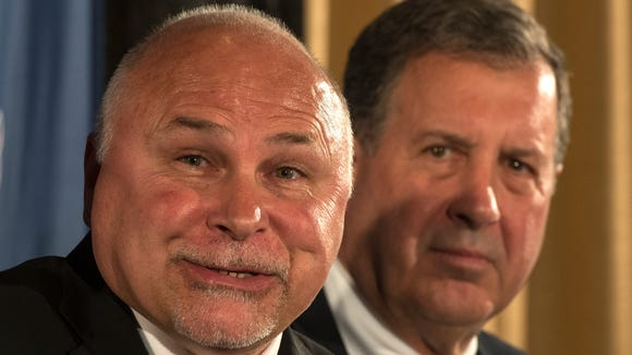 New Washington Capitals coach Barry Trotz, left, speaks during a news conference Tuesday as team president Dick Patrick looks on.