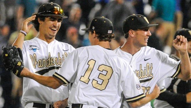 Vanderbilt pitchers Jared Miller, left, Walker Buehler (13) and Brian Miller, right, celebrate a 6-4 win over UC Irvine at the College World Series on Monday.