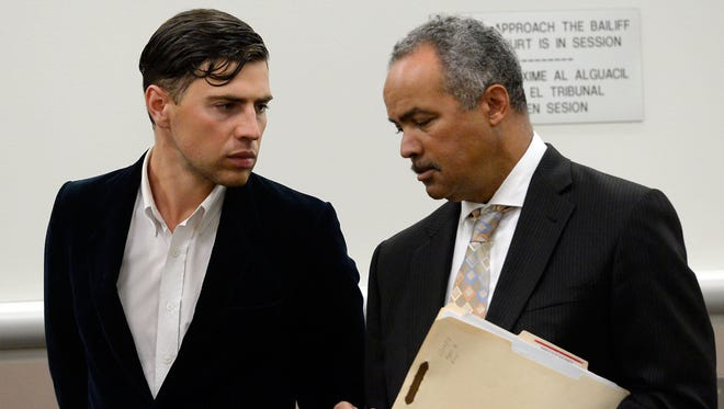 Vitalii Sediuk and lawyer Anthony Willoughby appear at the Los Angeles Superior Court House on May 30, 2014.