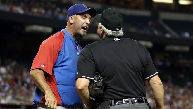 Chicago Cubs manager Dale Sveum argues with home plate umpire Dana DeMuth after being thrown out of the third inning of the the game against the Arizona Diamondbacks at Chase Field on July 23.