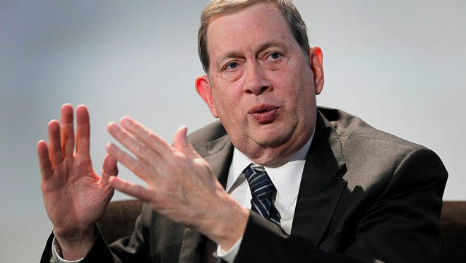 John C. Martin, chairman and chief executive officer of Gilead Sciences Inc., speaks at the Stanford Institute for Economic Policy Research in 2012 in Stanford, Calif.