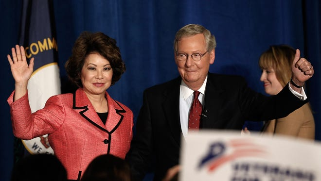 Senate Minority Leader Mitch McConnell, R-Ky., and his wife, Elaine Chao, arrive for a victory celebration following the early results of the state Republican primary on May 20, 2014, in Louisville.