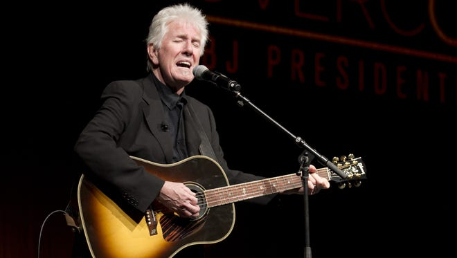 Rock and Roll Hall of Fame singer-songwriter Graham Nash performs at the Civil Rights Summit at the LBJ Presidential Library in Austin in April.