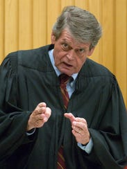 Knox County Criminal Court Judge Richard Baumgartner advises Lemaricus Davidson of his rights to testify during the penalty phase of his trial Thursday, Oct 29, 2009.
