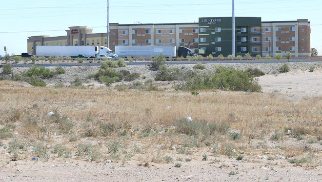 The Hampton Inn & Suites and Courtyard by Marriott hotels can be seen from a vacant, 30-acre site that city officials want to have turned into a mixed-use retail project. But the Tiguas claim in a new lawsuit that the tribe, not the city, owns the land.