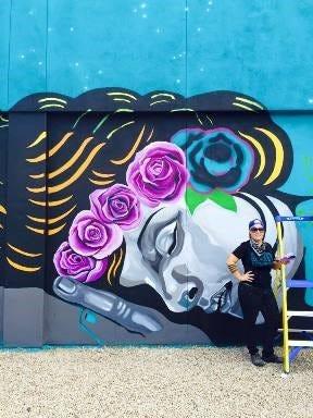 "Phoenix artist Lauren Lee at her mural, ""Don't Wake the Dreamer,"" in Tempe."