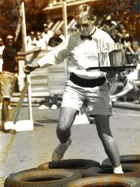 Jeff Crouse, a waiter at Nico's Catacombs, competes in the Waitron Race, a competition that sends servers scrambling over obstacles with trays full of drinks, in this photo from the 1991 NewWestFest.