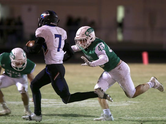 Wall's Lucas Garcia tries to tackle Midland Christian's