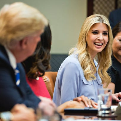 Ivanka Trump (center) sits in on a meeting with her